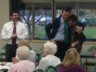 Gov. Dannel P. Malloy embraces Rosa DeLauro. At left, James Albis.