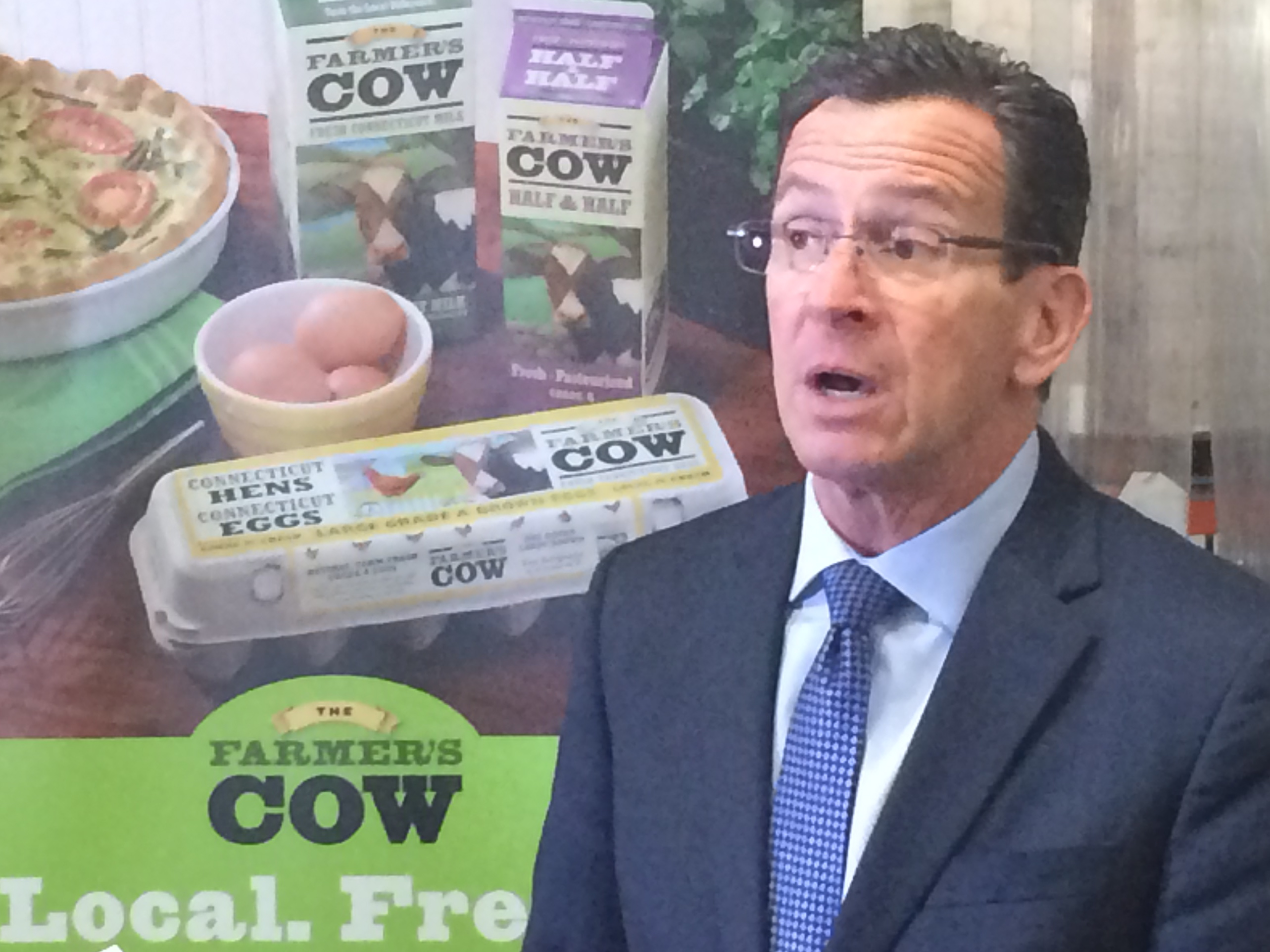 Malloy celebrates job gains on day marked by fiscal setbacks