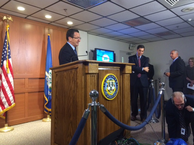 Gov. Dannel P. Malloy waiting for reporters Tuesday at a press conference.