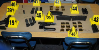 These are the weapons and ammunition found by police on Lanza after the shootings.