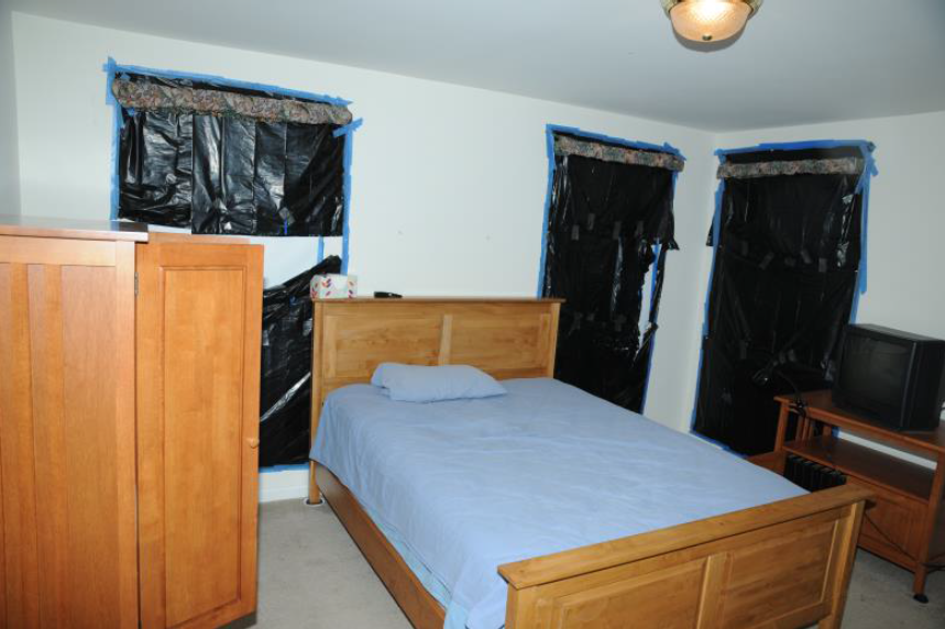 The windows in Adam Lanza's bedroom in the basement of his home were covered with trash bags.