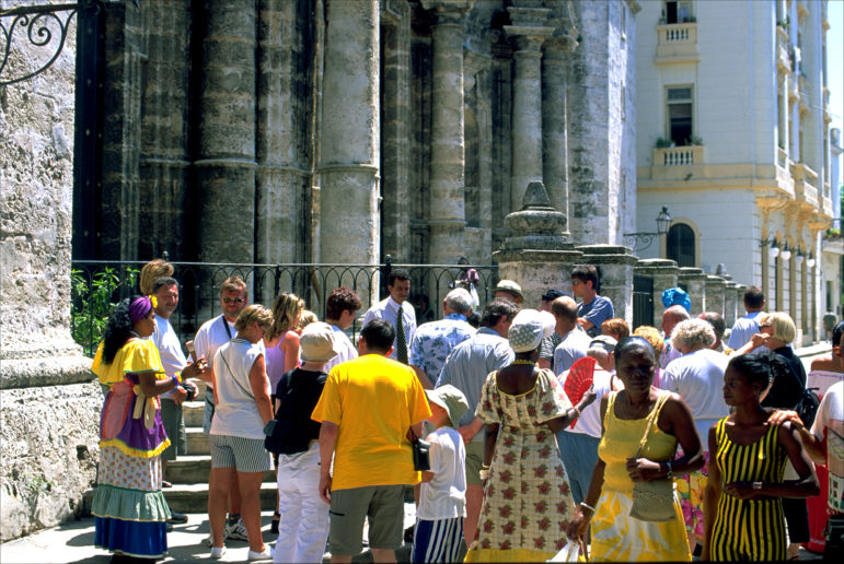 Foreign tourists enjoy the colonial architecture of Old Havana.