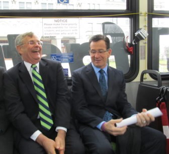 Gov. Dannel P. Malloy and   Transportation Commissioner James Redeker share a laugh at start of CT fastrak tour. (file photo)