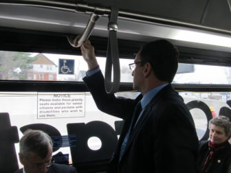 Strap-hanger-in-chief Dannel P. Malloy checks the view passing through Hartford.