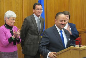 Andres Ayala Jr. with Gov. Dannel P. Malloy, Lt. Gov. Nancy Wyman and Melody Currey.