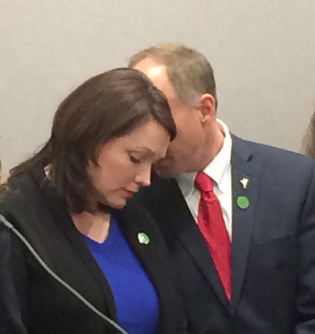 Nicole Hockley and Mark Barden, two Sandy Hook parents, share a moment Monday.