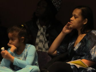 Sasha Rosa with her daughter at a recent State Board of Education meeting