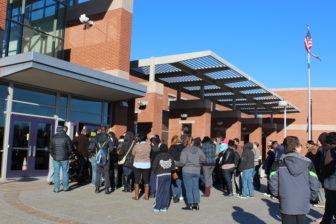 Parents wait with their children for a school choice fair in Southwest Hartford