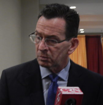 Gov. Dannel P. Malloy talks wth reporters after addressing the Connecticut Council of Small Towns