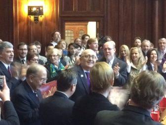 Sen. Andrew Maynard, D-Stonington, acknowledges applause on his return to the Senate.