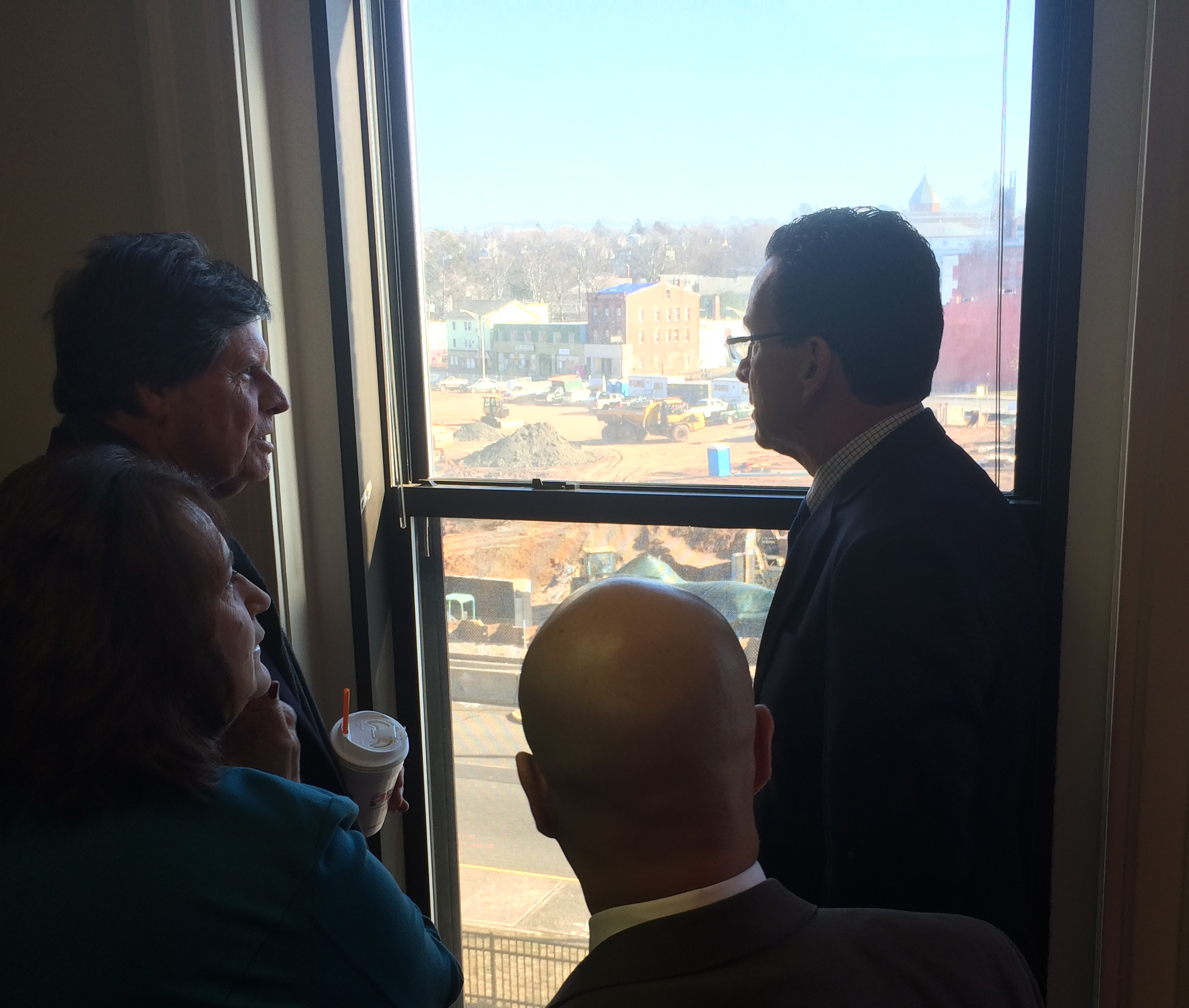Gov. Dannel P. Malloy and Rep. Buddy Altobello looking out on the site of a Meriden rail, park and flood-control project.