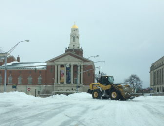 A payloader clears snow on Capitol Avenue in Hartford during a recent storm.
