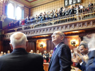 Sen. Andrew Maynard receives a lengthy standing ovation after he entered the chamber to be sworn in. Maynard sustained a traumatic brain injury after a fall in July and his ability to serve a fifth term was not clear. He surprised colleagues by returning in time to be sworn in.