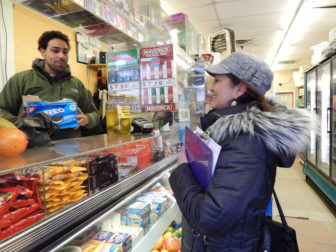 This is a picture of Marta Persia talking to Juan Brito about Obamacare in a mini mart in Hartford.
