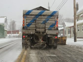A plow and materials spreader at work.