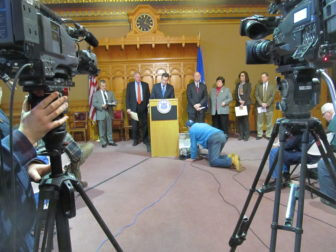 Gov. Dannel P. Malloy, Attorney General George Jepsen, Comproller Kevin Lembo and others at a televised news conference on the Anthem cyber attack.