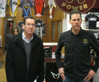 Gov. Dannel P. Malloy and Bill McEnery, owner of the Pedal Power bicycle shop in Middletown, Monday.