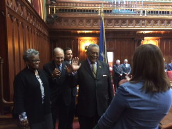 Edwin A. Gomes takes the  oath from Secretary of the State Denise Merrill. From left, Sens. Marilyn Moore, Martin Looney and Bob Duff.