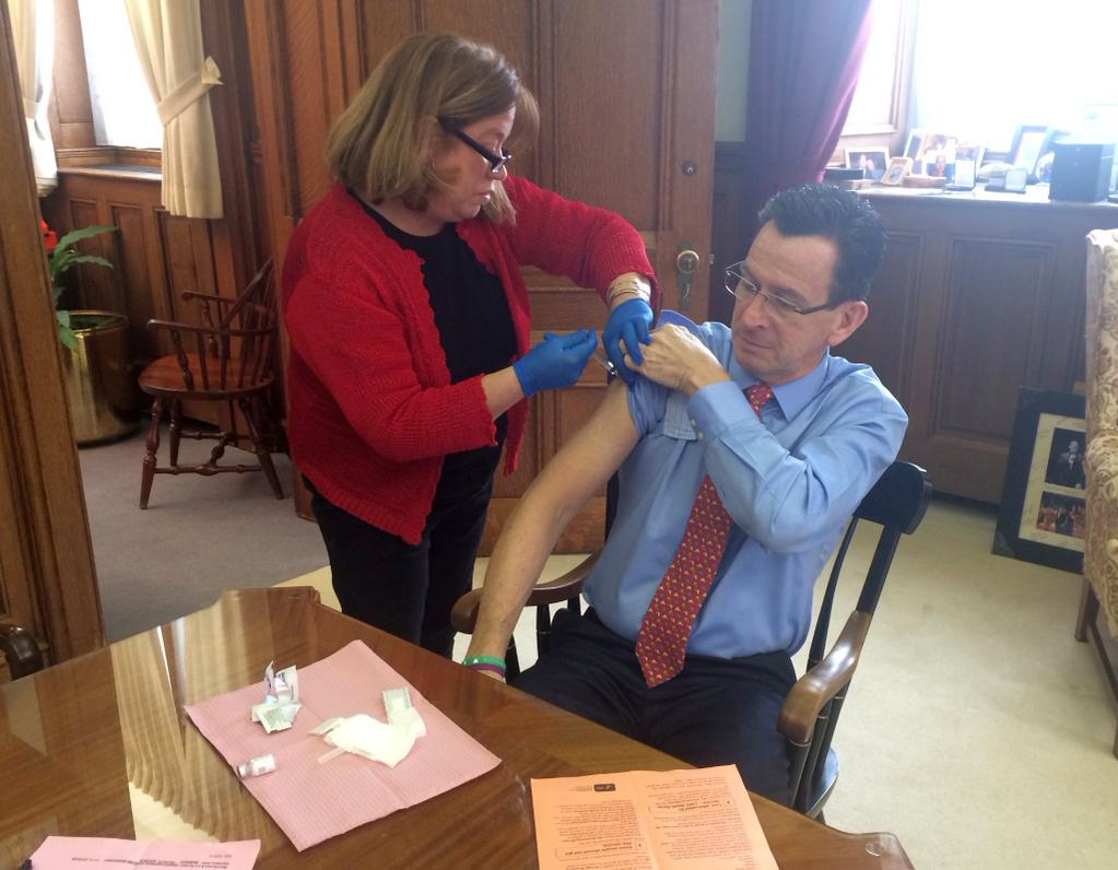 Malloy gets flu shot, then jabs Christie, Paul on vaccines