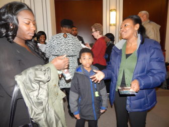 Parents hoping to get their children into a charter school traveled to Hartford last week. Pictured are parents from Stamford Nefretiria Gross (Left) and Dorothy St-Louis with her son.