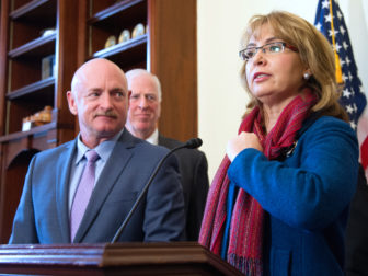 Former U.S. Rep. Gabrielle Giffords of Arizona and her husband, former astronaut Mark Kelly, at a press conference Wednesday marking re-introduction of a bill calling for expanded background checks for gun buyers.