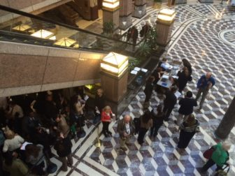 A line forms to testify at a public hearing on the governor's proposed budget.