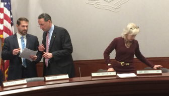 Sen. Paul Doyle, center, consults with staff at start of Energy and Technology Committee. At right is his co-chair, Rep. Lonnie Reed.