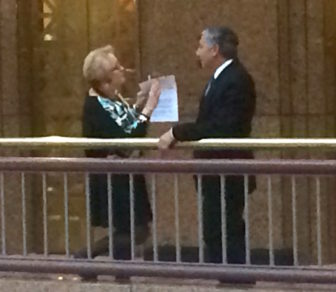 Rep. Minnie Gonzalez talking recently to Sen. Len Fasano about the confirmation of Chief Justice Chase T. Rogers.