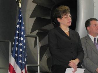 UConn President Susan Herbst listens as Gov. Dannel P. Malloy announces UConn's Next Generation plan in 2013.