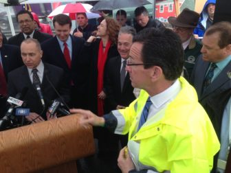 Gov. Dannel P. Malloy needed a raincoat at DOT news conference last year. He may be facing another rainy day.