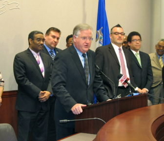 House Speaker J. Brendan Sharkey flanked by members of his task force that studied how to improve the education students who understand limited English receive.
