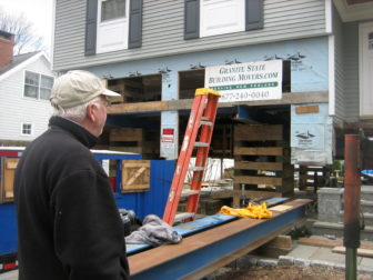 Dick Dmochowski of Fairfield, pictured, is having his Fairfield split-level elevated several feet.