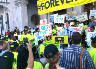 Gov. Dannel P. Malloy addresses a rally of charter school supporters at the state Capitol Thursday.