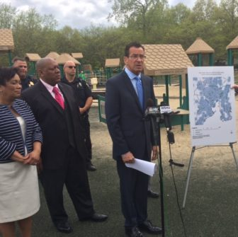 Gov. Dannel P. Malloy in New Haven with, from left, Mayor Toni Harp and NAACP President Scott Esdaile. The map shows how so-called school zones blanket the city.