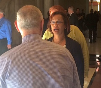 Rep. Toni Walker talks to Mark Ojakian, the governor's chief of staff, on the way into recent budget talks.