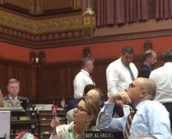 House Minority Leader Themis Klarides and Rep. Jason Perillo watch votes cast for GOP reforms.