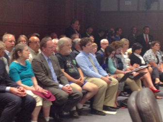 Spectators and waiting speakers at the Republican forum on tax increase proposals
