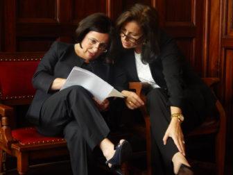 Republican Sen. Toni Boucher and Democratic Sen. Gayle Slossberg confer as Monday's special legislative session gets under way.