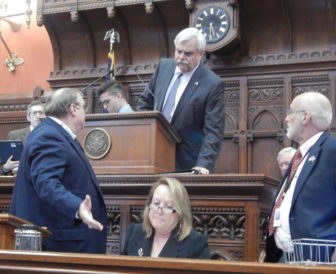 Rep. Bob Godfrey of Danbury presides over the House during Monday's special session.