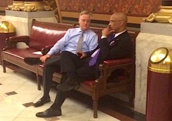 Speaker J. Brendan Sharkey speaks with Rep. Ernest Hewett of New London at 4 a.m. Wednesday.