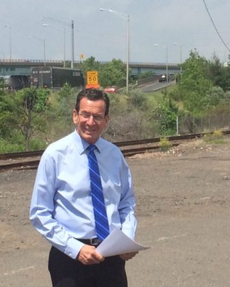Gov. Dannel P. Malloy by the Charter Oak Bridge on ramp that backs up afternoon, but not Tuesday.