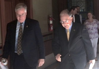 House Speaker J. Brendan Sharkey and Senate President Pro Tem Martin Looney on their way to a press conference after learning of Malloy's proposal to roll back business taxes.