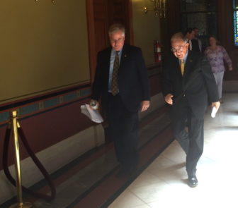House Speaker J. Brendan Sharkey and Senate President Pro Tem Martin Looney on their way to a press conference after learning of Malloy's plan.
