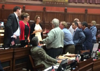 Republican legislators gather around House Minority Leader Themis Klarides before the beginning of the budget debate.