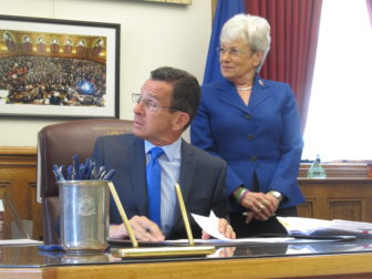 Gov. Dannel P. Malloy and Lt. Gov. Nancy Wyman at the signing of the budget bills.