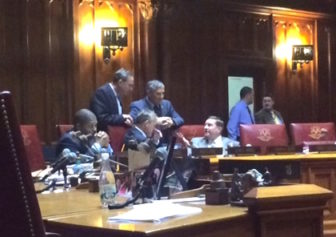 Senate Minority Leader Len Fasno, standing at center, with colleagues during Second Chance debate.