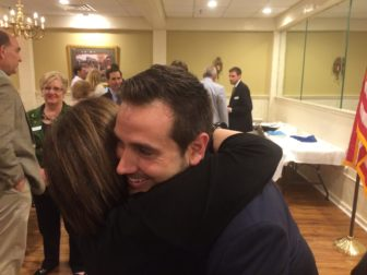 J.R. Romano is congratulated by Ruby O'Neill, wife of Rep. Art O'Neill.