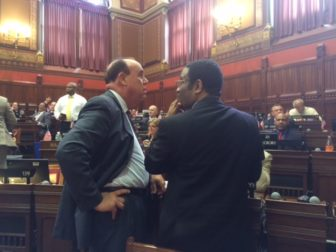 Reps. Stephen Dargan, left) and Bruce Morris during a debate on a police excessive force bill.