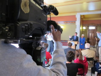 Gov. Malloy answers questions from reporters outside his Capitol office the morning after the annual legislative session ended.