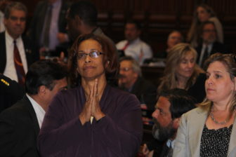 Rep. Toni Walker, the chairwoman of the legislature's Appropriations Committee, watches the vote board in the House